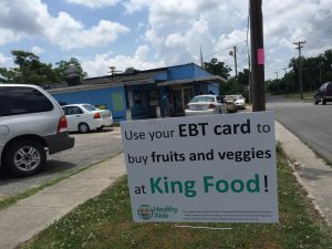 Advertising for the Healthy Aisle Program outside of King Food Convenience Store in Kinston, NC