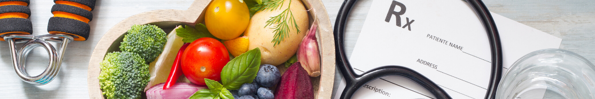 Photo of fruits and vegetables, stethoscope, and prescription pad