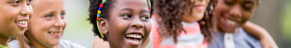 Elementary school kids smiling outside