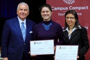 Photo of Jessica Soldavini receiving her award with Board member and faculty winner