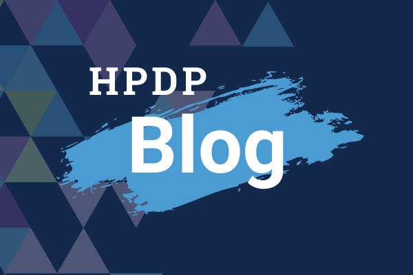 Graphic that says HPDP Blog with triangle pattern in the background